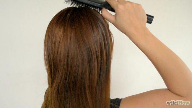 Як зробити неохайну високу зачіску